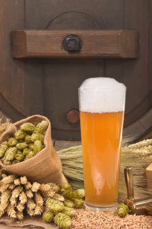 beerglass: beer glass and beer barrel with hops, wheat, grain, barley and malt Stock Photo