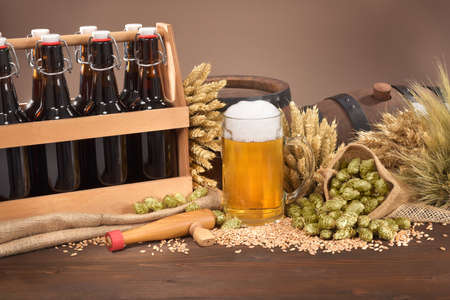 beerglass: beer crate, beer barrel and beer glass with hops, wheat, grain, barley and malt Stock Photo