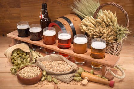 wheat beer: beer crate with many different beers, hops, wheat, grain, barley and malt