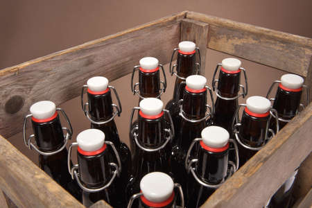close-up view of many beer bottles with clip closure in old beer crate
