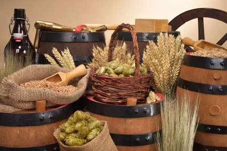 beer barrel, beer bottle, hammer and spigot with hops, wheat, grain, barley and malt Stock Photo
