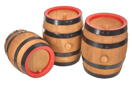 Three old beer barrels with red rings isolated on white Stock Photo