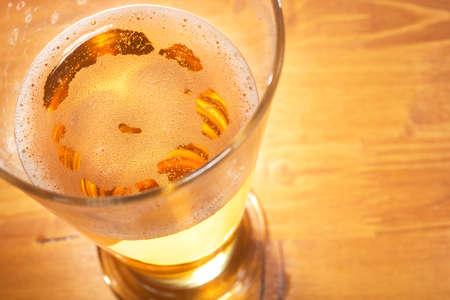 macro view of a beer glass on the table with froth Stock Photo