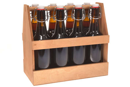 Wooden beer crate with clip closure beer bottles isolated on white Stock Photo