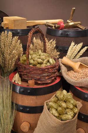 beer barrel, hammer and spigot with hops, wheat, grain, barley and malt