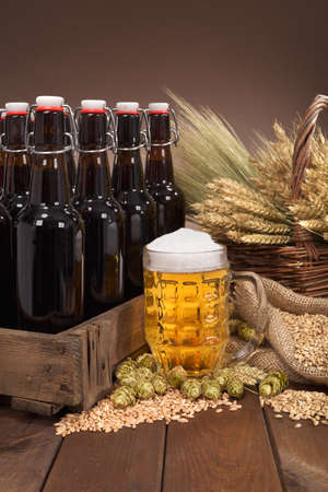 beerglass: beer crate and beer glass with hops, wheat, grain, barley and malt Stock Photo