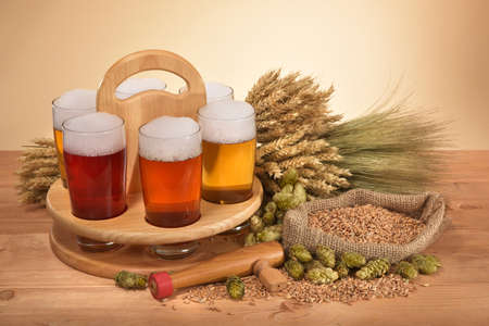 beer crate and beer glasses with hops, wheat, grain, barley and malt