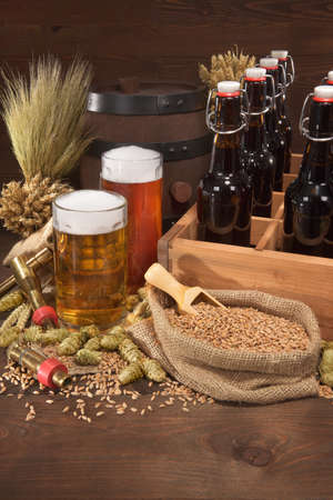 beerglass: beer crate with different beers, hops, wheat, grain, barley and malt
