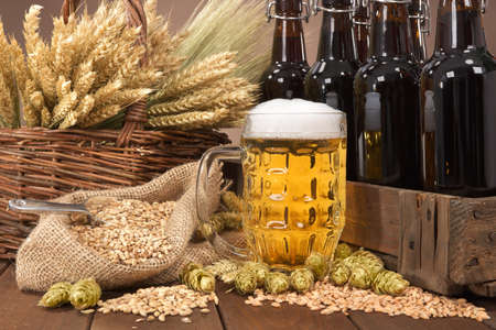 beer crate and beer glass with hops, wheat, grain, barley and malt Stok Fotoğraf