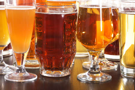 Many different beer glasses with beer from all over the world Stock Photo - 55648326