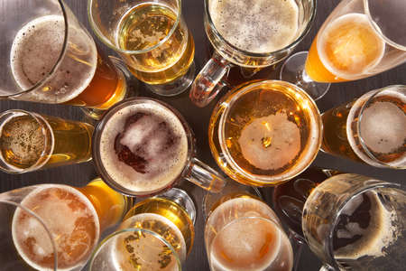 Many different beer glasses with beer from all over the world Stock Photo