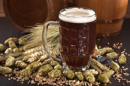 beer glass, beer barrels, hops, wheat, grain, barley and malt