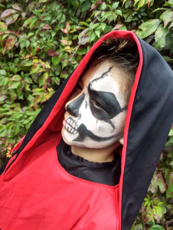 Day of the Dead (Halloween) photo session with a skull make-up Stock Photo