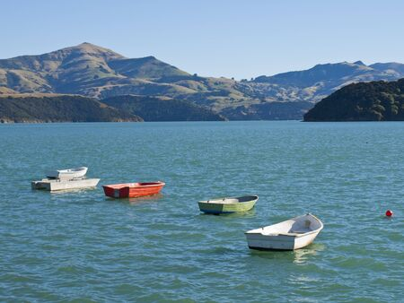 smal: Smal oared boats on a lake in Akaora, New Zealand