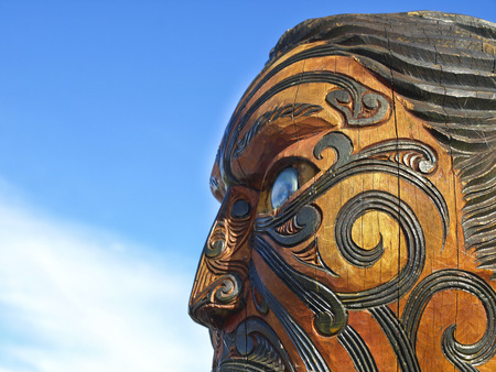 Traditional Maori carving, face mask carved in wood  Rotorua, New Zealand  photo