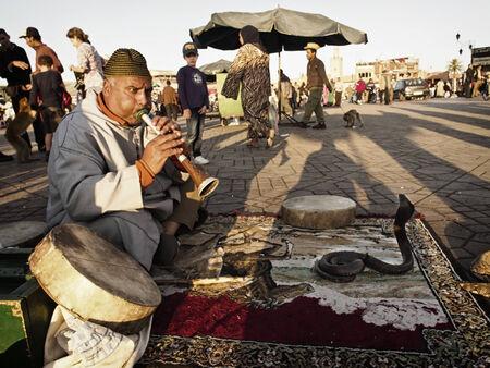 Marrakesh - MAR 28  Snake charmer at Djemaa el-Fna square, Morocco on Mar 28, 2013