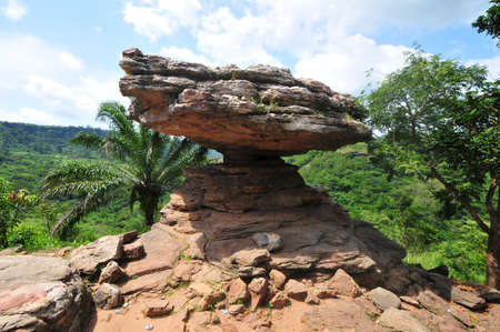Umbrella Rock in the Yilo Krobo District, outside of Accra, Ghana. The Umbrella Rock is about thirty minutes walk in the forest from Boti falls. The umbrella Rock is sited on a high land and thus, making it possible to watch nature hundreds of miles away  Stock Photo