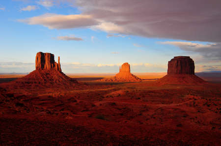 Sandstone formation in Monument Valley during sunset as storm clouds are rolling in.