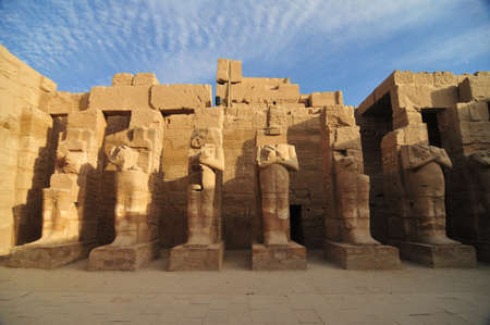 pharoah: Egyptian Statues forming Karnak, a vast mix of decayed temples, chapels, pylons, and other buildings