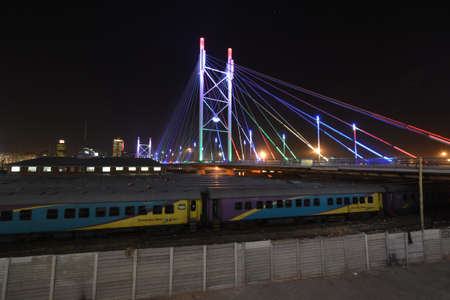johannesburg: Nelson Mandela Bridge, in Johannesburg, South Africa  The bridge was constructed over 42 railway lines without disturbing railway traffic and is 284 metres long, completed in 2003
