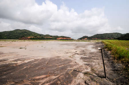 effluent: Filled Tailings Pond in Ghanaian Mining Operation