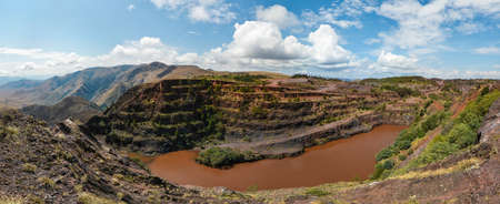 The Ngwenya Mine is located on Bomvu Ridge, northwest of Mbabane and near the north-western border of Swaziland  This mine is considered to be the world Stock Photo