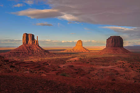 View of Monument Valley as Storm Clouds approach at sunset photo