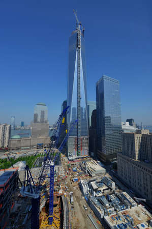 View looking East at the World Trade Center under construction, with the newly attached spire with 7 World Trade Center next door