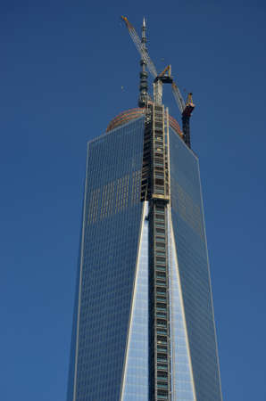 Top of 1 World Trade Center under construction, with the newly attached spire reaching a full 1776 feet