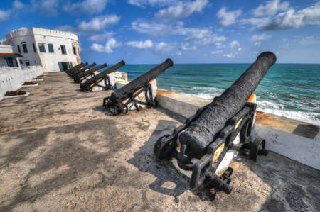 Cannons overlooking from Cape Coast Castle  Cape Coast Castle is a fortification in Ghana built by Swedish traders for trade in timber and gold  Later the structure was used in the trans-Atlantic slave trade