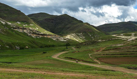 enclave: Mounted Sotho Man riding away into Lesotho Landscape  Lesotho, officially the Kingdom of Lesotho, is a landlocked country and enclave