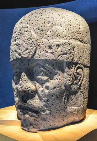 An Olmec colossal head sculpted from a large basalt boulder  The head dates from at least before 900 BC and is a distinctive feature of the Olmec civilization of ancient Mesoamerica  Editöryel