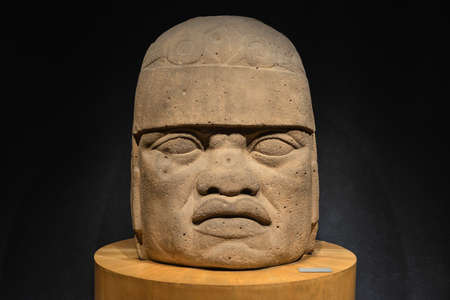 mesoamerica: An Olmec colossal head sculpted from a large basalt boulder  The head dates from at least before 900 BC and is a distinctive feature of the Olmec civilization of ancient Mesoamerica  Editorial