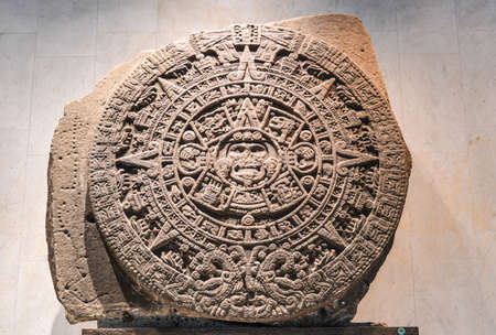 inscribed: The Aztec calendar stone, Mexica sun stone, Stone of the Sun  or Stone of the Five Eras, is a large monolithic sculpture that was excavated in the Zócalo, the main square of Mexico City, on December 17, 1790  Editorial