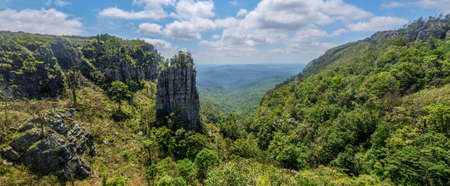quartzite: The Pinnacle Rock, a tower-like freestanding quartzite buttress which rises 30 m above the dense indigenous forest in Mpumalanga, South Africa