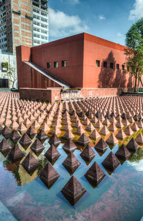 mexico city: Plaza Juarez, Mexico City, Mexico  A set of 1034 reddish pyramids in a broad pool in Plaza Juarez