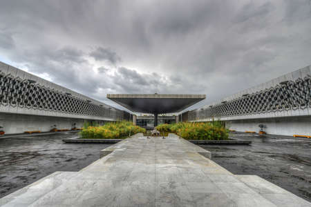 The plaza of the Museo Nacional de Antropologia  MNA, or National Museum of Anthropology  is a national museum of Mexico  In the middle is a vast square concrete umbrella of cascading water