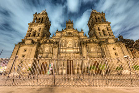 Mexico City Metropolitan Cathedral  Catedral Metropolitana de la Asuncion de Maria  at night  It is the largest and oldest cathedral in the Americas, built in 1573-1813  Editorial