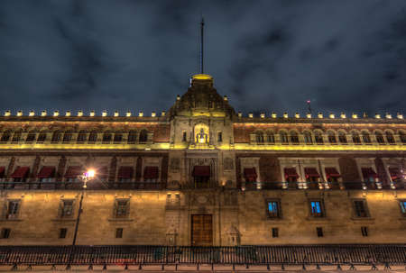 Illuminated National Palace in Plaza de la Constitucion of Mexico City at Night