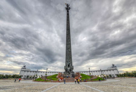 slaying: Poklonnaya Hill Obelisk, in Victory Park, Moscow, Russia  Statue of Nike on top with Saint George slaying a dragon below  Commemorating the victory over the Nazis in World War II  Editorial