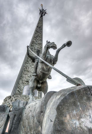 winning location: Poklonnaya Hill Obelisk, in Victory Park, Moscow, Russia  Statue of Nike on top with Saint George slaying a dragon below  Commemorating the victory over the Nazis in World War II  Editorial