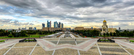 winning location: View from Poklonnaya Hill in Victory Park, Moscow, Russia  View of Moscow City under construction and Saint George Editorial