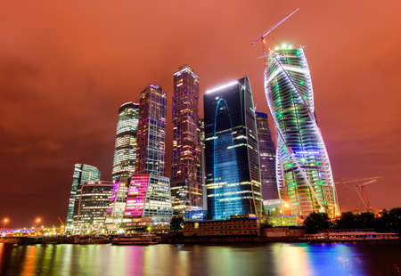 Moscow City skyscrapers at night reflected in the Moskva River