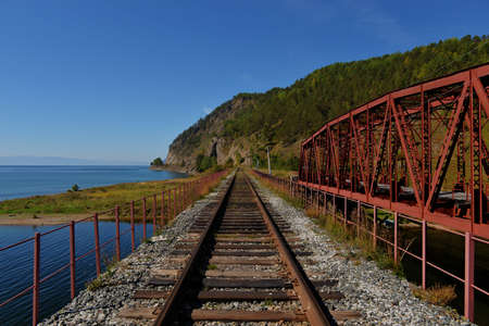 The Circum-Baikal Railway Bridge - a historical railway that runs along Lake Baikal in the Irkutsk region of Russia  photo