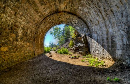 The Circum-Baikal Railway Abandoned Tunnel  The Circum-Baikal Railway - a historical railway that runs along Lake Baikal in the Irkutsk region of Russia  photo