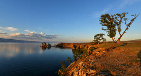 Shaman Rock at Sunset, Island of Olkhon, Lake Baikal, Russia on a Summer Day photo