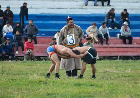 naadan: IVOLGINSKY REGION, BURYATIA - SEPTEMBER 9, 2013  Three Games of a Man - Eleventh Annual Wrestling event in Ulan-Ude  Traditional Mongolian-style wrestling