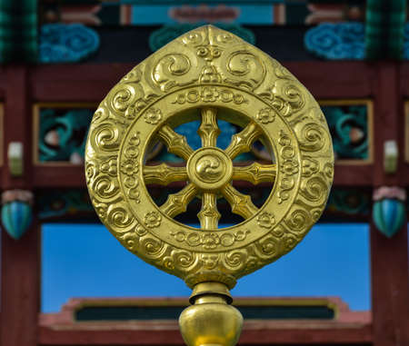 shakti: Dharmacakra or the Wheel of the Law  Golden symbol in the Ivolginsky Datsan in Ulan-Ude, Buryatia, Russia  The dharmacakra is one of the oldest known Buddhist symbols