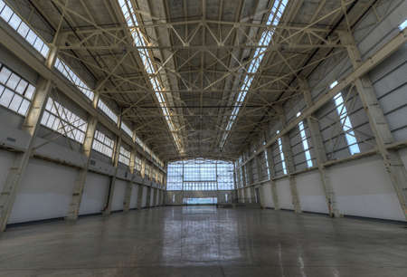 empty warehouse: Newly constructed empty warehouse factory during the day, filled with natural light