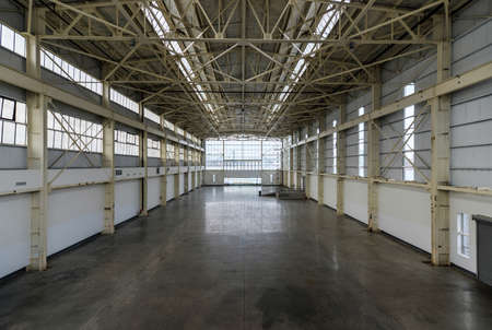 empty warehouse: Newly constructed empty warehouse factory during the day, filled with natural light, photographed from above